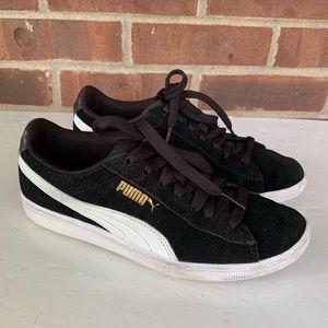 Puma black suede low top sneakers